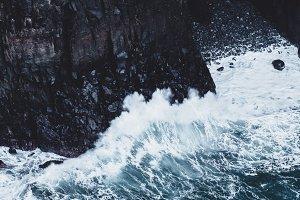Waves Crashing on Dark Rocks