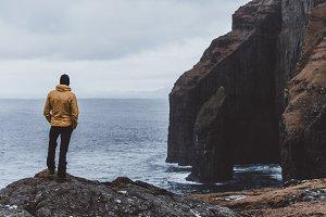 Man Standing on High Cliffs