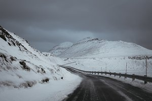 Icy Mountain Road in Snowy Landscape
