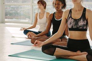 Women meditating in lotus pose