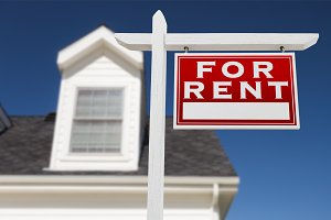For Rent Real Estate Sign and House
