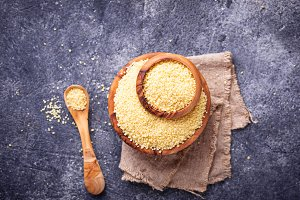 Couscous grain in wooden bowl