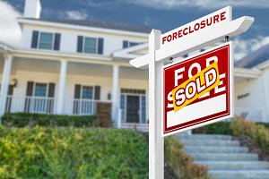 House & Foreclosure Sold Sign