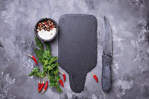 Herbs, spices and slate cutting board