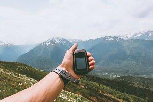 Traveler hand holding gps navigator