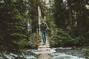 Man Traveler crossing river