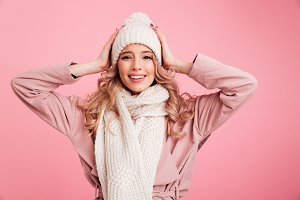 Happy young woman wearing warm scarf