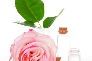 Pink rose and glass bottles