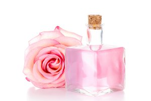 Pink rose and glass bottle