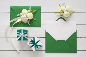 Envelopes decorated with white roses