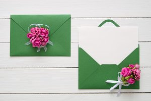Envelopes decorated with pink roses.