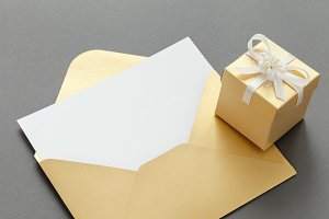 Envelope with sheet and gift box.