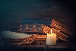 Old books and candle.