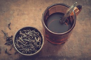 Tea mug and dry tea leaves.