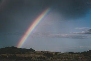 Rainbow over Barren Landscape