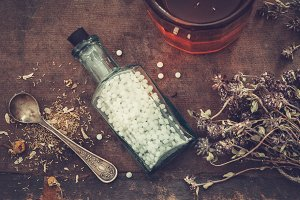 Homeopathic bottle and healthy herbs