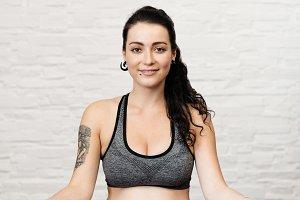 Happy pregnant woman in sportswear.