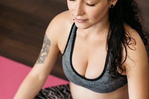 Pregnant woman doing yoga.