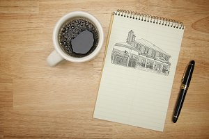 Coffee and Paper with House Drawing