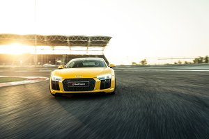 Yellow Sport Car (Audi R8) in Motion