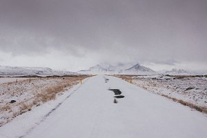 Snowy Winter Road towards Mountains