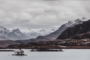 Snowy Mountains and Lake in Scotland
