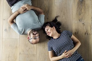 Family lying on wooden floor
