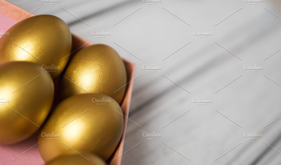 Golden easter eggs in gift box holiday photos creative market golden easter eggs in gift box holidays negle Choice Image