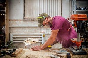 Man sanding a wooden