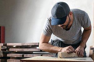 Carpenter work at milling machine