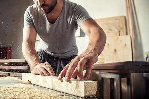 Carpenter working  at wooden bar