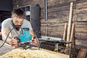 Man work with  milling machine
