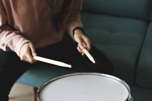 White woman playing drum