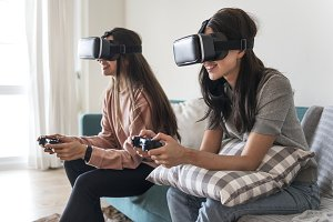 Women experiencing VR headset