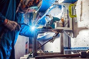 A young man welder