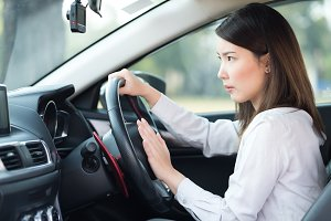Woman pressing horn while driving