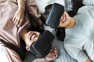 Women experiencing with VR headset