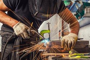 A strong man welder