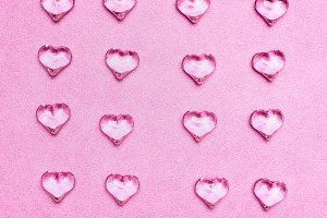 Glass hearts flat lay on pink
