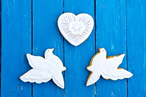 Two white pigeons and a heart. Turqu