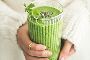 Matcha green smoothie with chia seeds and mint, square crop