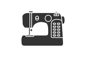 Sewing machine glyph icon