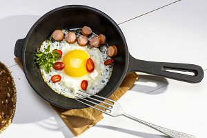 fried egg with pieces of sausage