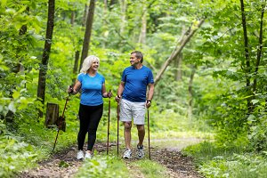 Elderly couple enjoying summer walk