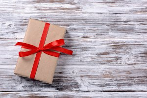 gift box with red ribbon, white pain