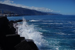 photo of waves lapping a rocky shore in Tenerife