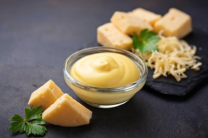 Homemade cheese sauce in glass bowl