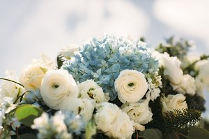 Beautiful flowers and decoration on table in wedding day, winter