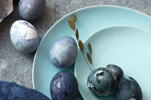 Beautiful Easter eggs with painted galaxy on plates
