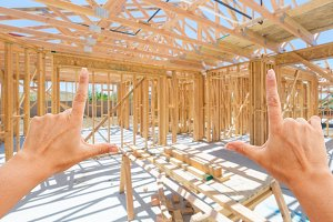 Hands Framing Home Construction Site